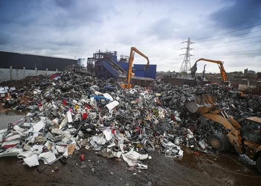 Cranes working with scrap metal pile