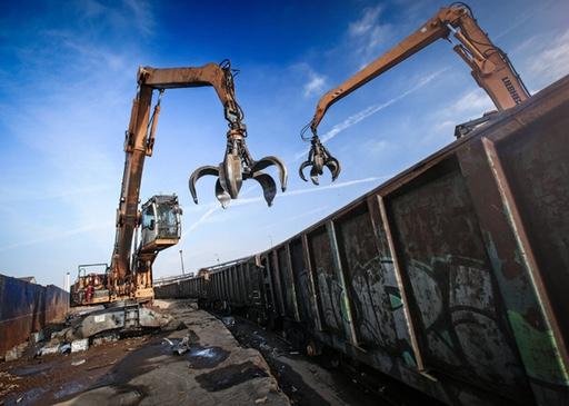 Cranes working in scrap metal yard