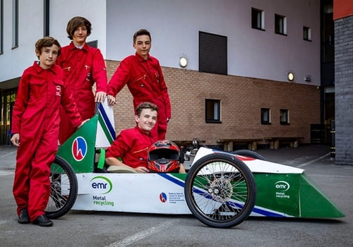 Youths with racing car
